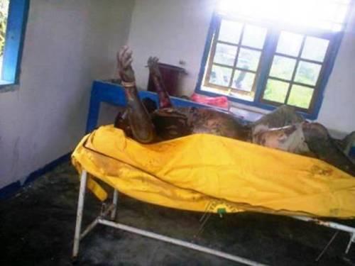 Mayat Deni Bahabol, anggota KNPB Yahukimo yang di culik da di bunang di sungai Braza. Jenaza korban dalam tangan terangkat di ruang mayat di RDU Dekai Kab. Yahukimo